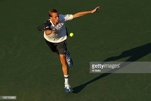Kristof Vliegen of Belgium hits a return against James Blake of the United States during his first round men's single's match on day two of the 2010...