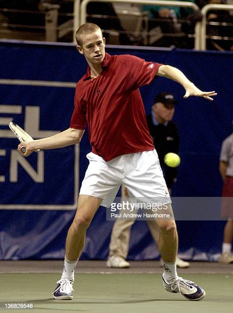 Kristof Vliegen of Belgium hits a return shot during his match with Andy Riddick at the 2004 Siebel Open in San Jose, California, February 12, 2004....