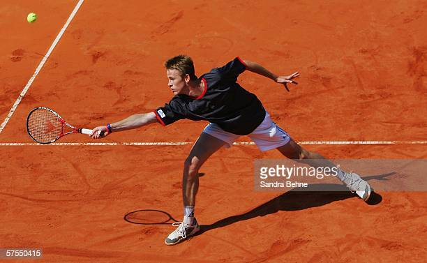 Kristof Vliegen of Belgium in action against Olivier Rochus of Belgium during the final of the BMW Open at the Iphitos tennis club on May 7, 2006 in...