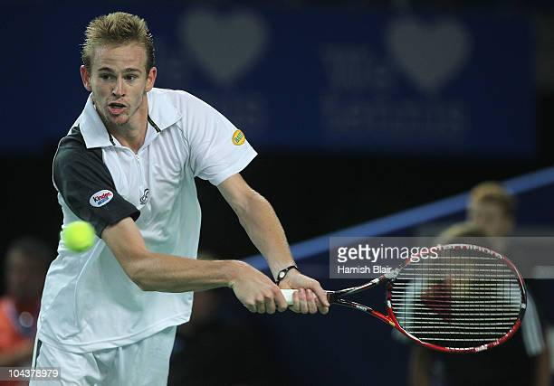 Kristof Vliegen of Belgium plays a backhand during his match against Jarkko Nieminen of Finland during day four of the Open de Moselle at Les Arenes...