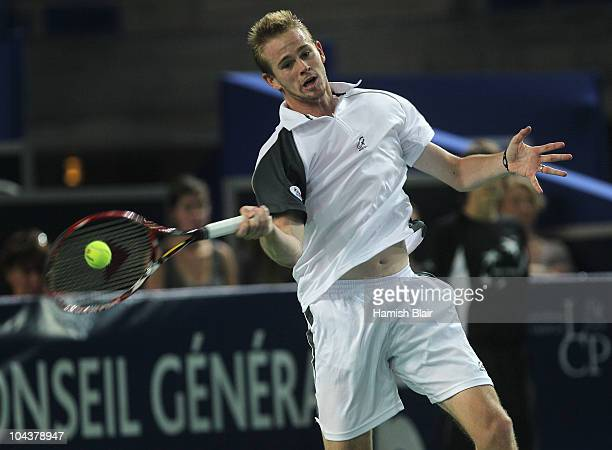 Kristof Vliegen of Belgium plays a forehand during his match against Jarkko Nieminen of Finland during day four of the Open de Moselle at Les Arenes...