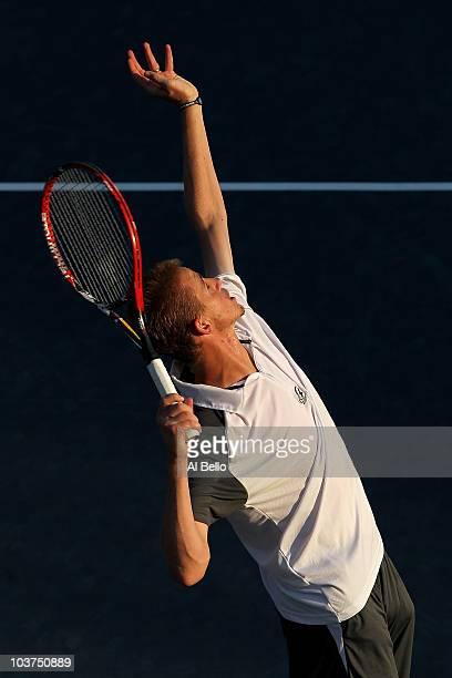 Kristof Vliegen of Belgium serves against James Blake of the United States during his first round men's single's match on day two of the 2010 U.S....
