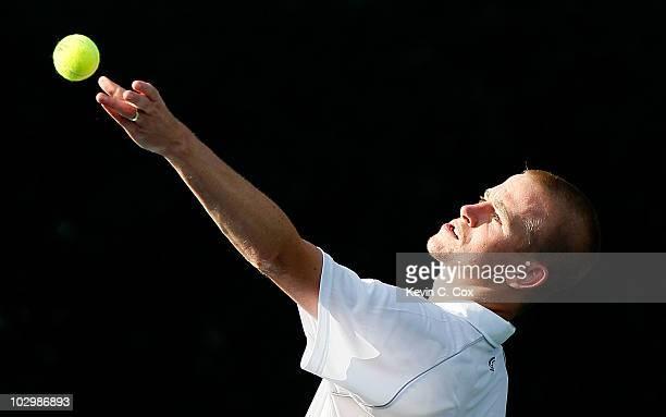 Kristof Vliegen of Belgium serves to Illya Marchenko of the Ukraine on Day 1 of the Atlanta Tennis Championships at the Atlanta Athletic Club on July...