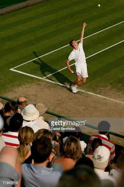 Kristof Vliegen of Belgium serves to Mark Knowles of Bahamas and Daniel Nestor of Canada while playing with Yves Allegro of Switzerland during day...
