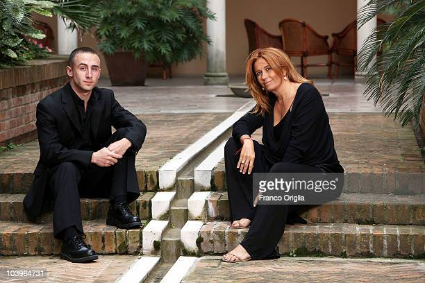 Kristofer Goldsmith and filmmaker Monica Maggioni pose at the Ward 54 portrait session during the 67th Venice Film Festival on September 7 2010 in...