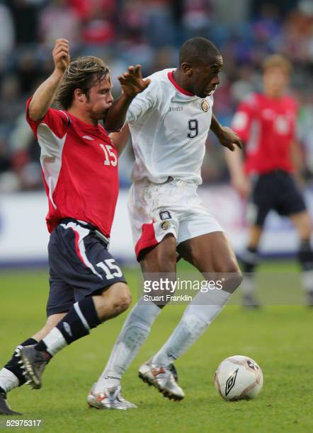Kristofer Haestad of Norway in action against Paulo Wanchope of Costa Rica during The International Friendly match between Norway and Costa Rica at...
