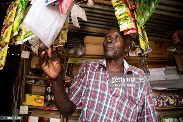 Kristoff a shopkeeper in Butogo western Uganda near the border with Democratic Republic of Congo speaks in his shop on August 17 2018 He says he was...