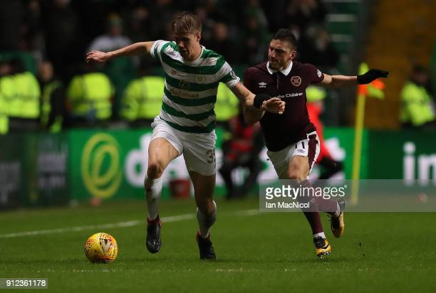 Kristoffer Ajer of Celtic vies with Manuel Milinkovic of Hearts of Midlothian during the Scottish Premier League match between Celtic and Heart of...