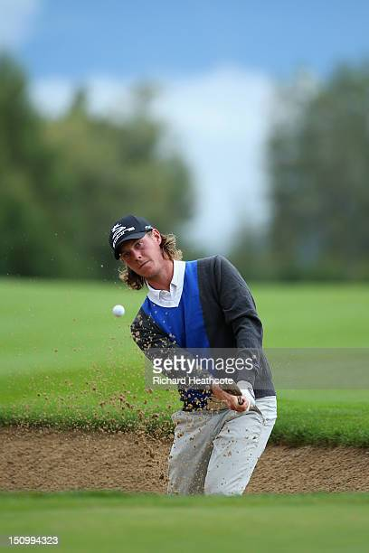 Kristoffer Broberg of Sweden holes a bunker shot on the 15th for eagle during the first round of the Omega European Masters at CranssurSierre Golf...