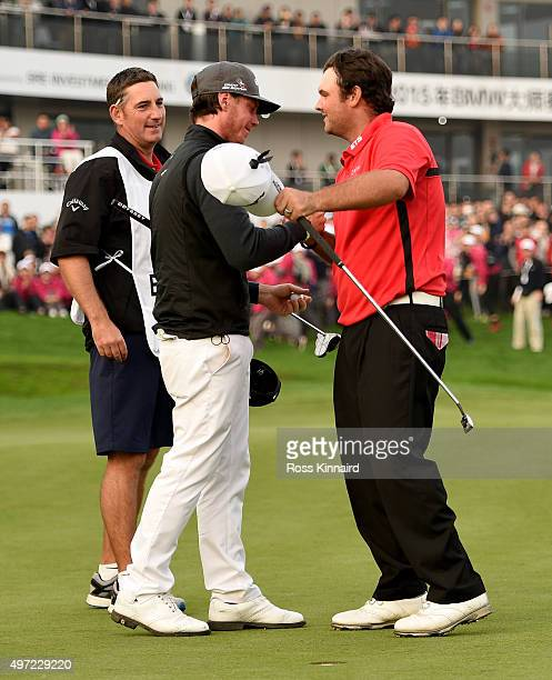 Kristoffer Broberg of Sweden is congratulated by Patrick Reed of the United States after the first playoff hole during the final round of the BMW...