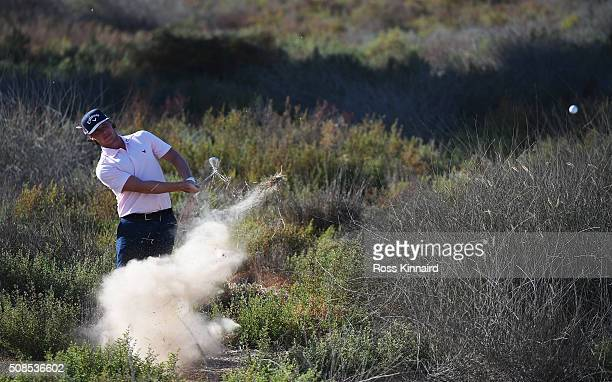 Kristoffer Broberg of Sweden plays out of trouble on the 17th hole during the second round of the Omega Dubai Desert Classic at the Emirates Golf...