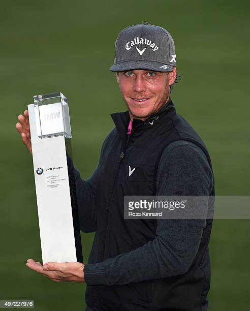 Kristoffer Broberg of Sweden with the winners trophy after the final round of the BMW Masters at Lake Malaren Golf Club on November 15 2015 in...