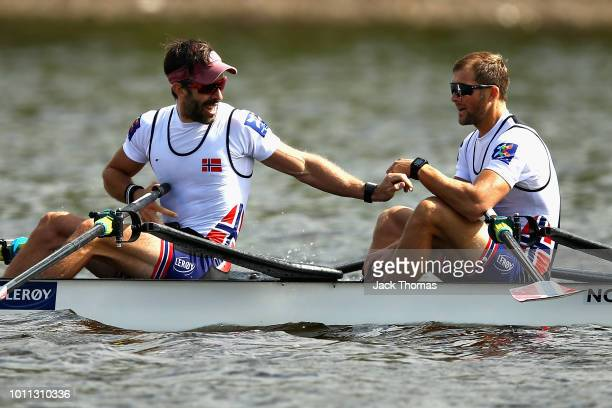 Kristoffer Brun and Are Strandli of Norway celebrate winning gold in the final of the Lightweight Men's Double Sculls during the rowing on Day Four...