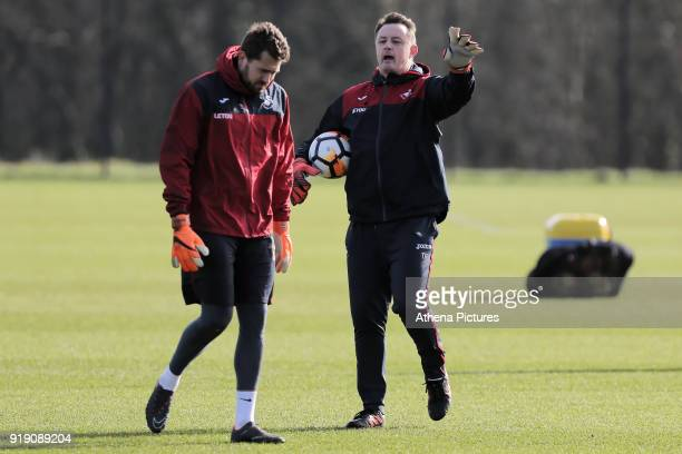 Kristoffer Nordfeldt and Tony Roberts goalkeeping coach in action during the Swansea City Training at The Fairwood Training Ground on February 15...