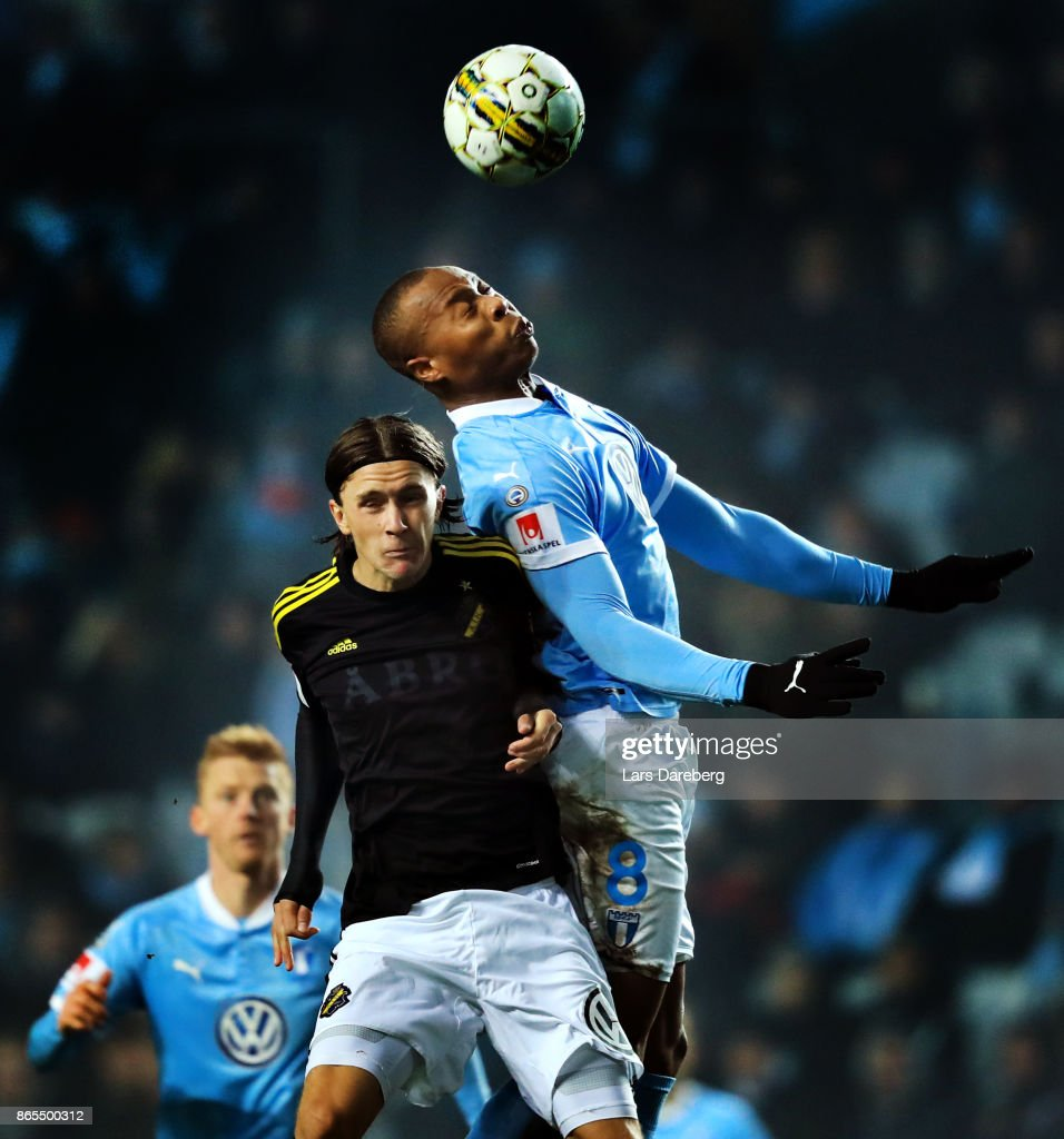 Kristoffer Olsson of AIK and Carlos Strandbergof Malmo FF during the allsvenskan match between Malmo FF and AIK at Swedbank Stadion on October 23, 2017 in Malmo, Sweden.