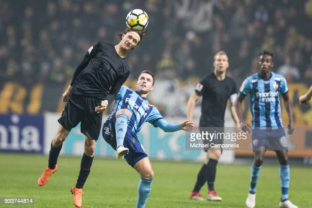 Kristoffer Olsson of AIK clears the ball with his head during a semifinal match of the Swedish Cup between AIK and Djurgardens IF at Friends arena on...
