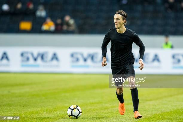 Kristoffer Olsson of AIK runs with the ball during a Swedish Cup quarter final match between AIK and Orebro SK at Friends arena on March 13 2018 in...
