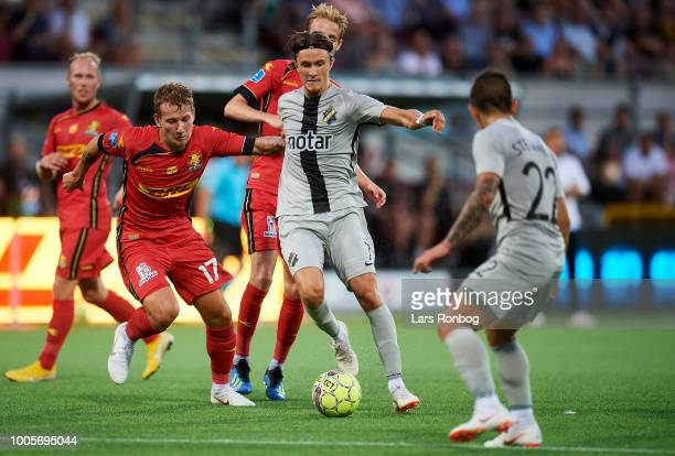 Kristoffer Olsson of AIK Stockholm and Andreas Skovgaard of FC Nordsjalland compete for the ball during the UEFA Europa League Qual match between FC...