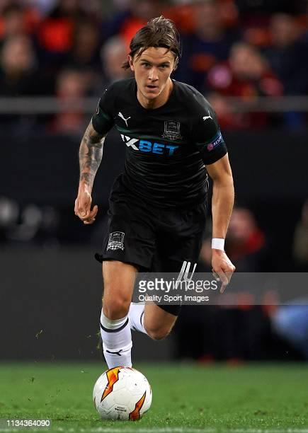 Kristoffer Olsson of Krasnodar runs with the ball during the UEFA Europa League Round of 16 First Leg match between Valencia v Krasnodar at Estadi de...