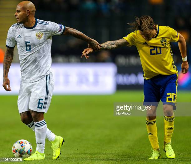 Kristoffer Olsson of Sweden and Ari of the Russia vie for the ball during the UEFA Nations League B group two match between Sweden and Russia at...