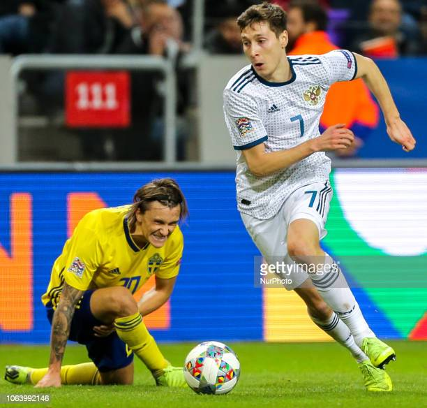 Kristoffer Olsson of Sweden and Daler Kuzyaev of the Russia vie for the ball during the UEFA Nations League B group two match between Sweden and...
