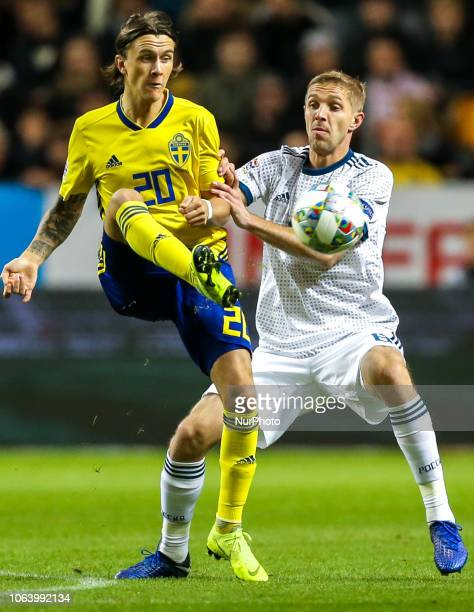 Kristoffer Olsson of Sweden and Yuri Gazinski of the Russia vie for the ball during the UEFA Nations League B group two match between Sweden and...