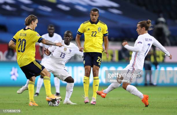 Kristoffer Olsson of Sweden is challenged by N'Golo Kante and Antoine Griezmann of France as Robin Quaison of Sweden looks on during the UEFA Nations...