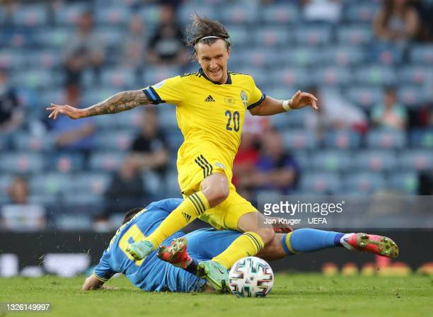 Kristoffer Olsson of Sweden is challenged by Roman Yaremchuk of Ukraine during the UEFA Euro 2020 Championship Round of 16 match between Sweden and...