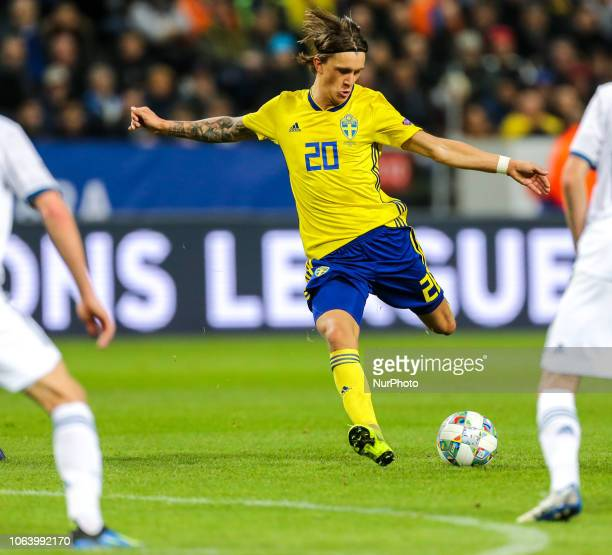 Kristoffer Olsson of Sweden vie for the ball during the UEFA Nations League B group two match between Sweden and Russia at Friends Arena on November...