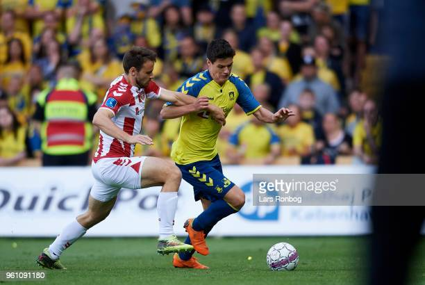 Kristoffer Pallesen of AaB Aalborg and Christian Norgaard of Brondby IF compete for the ball during the Danish Alka Superliga match between Brondby...