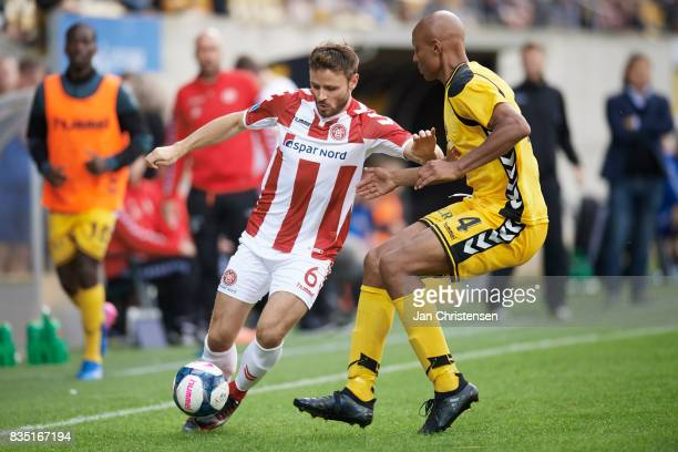 Kristoffer Pallesen of AaB Aalborg and Simon Okosun of AC Horsens compete for the ball during the Danish Alka Superliga match between AC Horsens and...