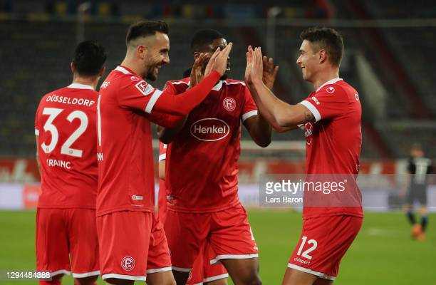 Kristoffer Peterson of Fortuna Duesseldorf celebrates with his team mates after scoring their team's first goal during the Second Bundesliga match...