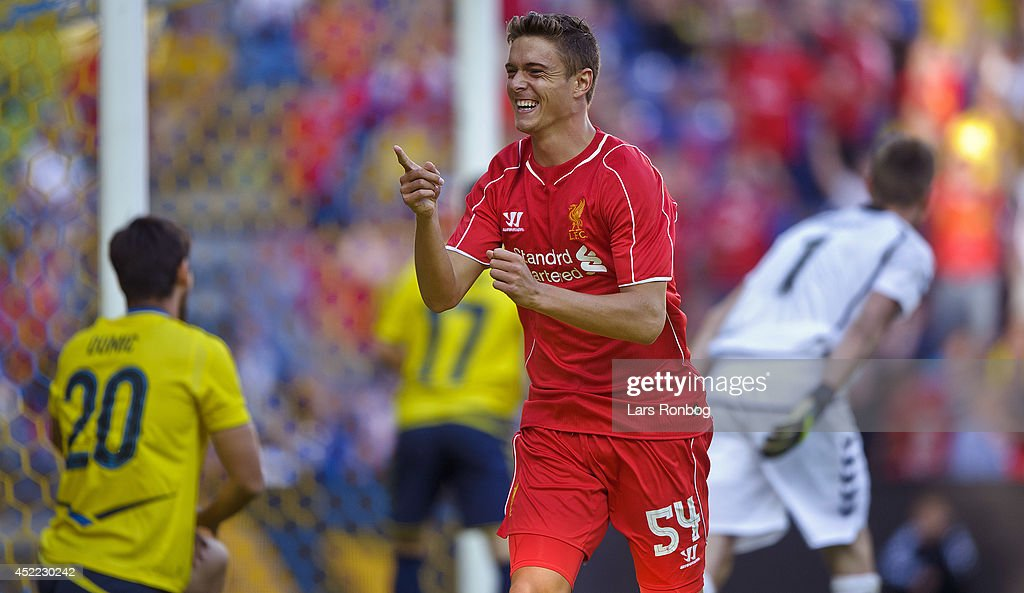 Kristoffer Peterson of Liverpool FC celebrates after scoring their first goal during the Pre-Season Friendly match between Brondby IF and Liverpool FC at Brondby Stadion on July 16, 2014 in Brondby, Denmark.