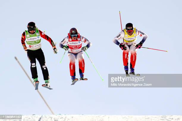 Kristofor Mahler of Canada takes 1st place, Bastien Midol of France takes 2nd place, Jean Frederic Chapuis of France takes 3rd place during the FIS...