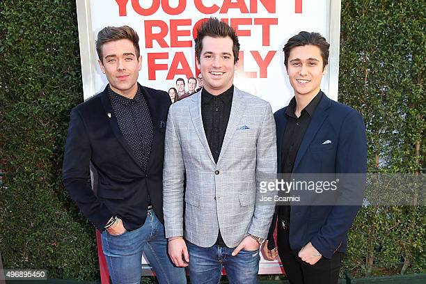 Kristopher James Kyle Carpenter and Aleksey Lopez attend the Love The Coopers Holiday Luncheon Benefiting The LA Regional Food Bank at The Grove on...