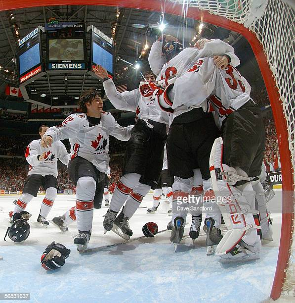Kristopher Letang of Team Canada and teammates crowd around goaltender Justin Pogge after defeating Team Russia 5-0 in their World Junior Hockey...