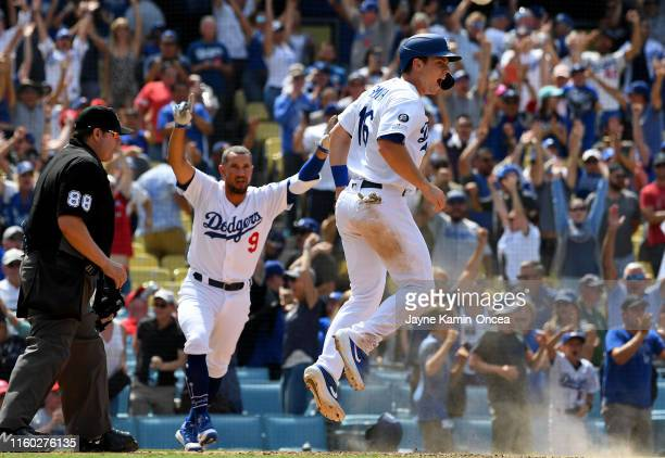 Kristopher Negron celebrates after Will Smith scored the winning run on a two RBI walkoff single by Russell Martin of the Los Angeles Dodgers against...