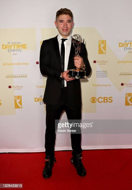 """Kristos Andrews poses with the award for Outstanding Performance by a Lead Actor in a Daytime Fiction Program for """"The Bay"""" during the 48th Annual..."""