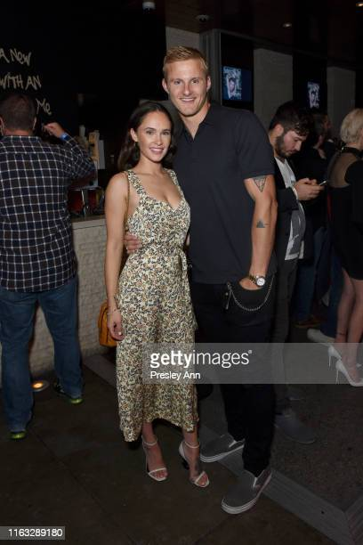 Kristy Dawn Dinsmore and Alexander Ludwig attend Entertainment Weekly's ComicCon Bash held at FLOAT Hard Rock Hotel San Diego on July 20 2019 in San...