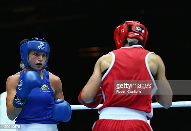Kristy Harris of Australia competes against Mandy Bujold of Canada in the Women's Fly 4851kg Division Boxing quarterfinals at Scottish Exhibition And...