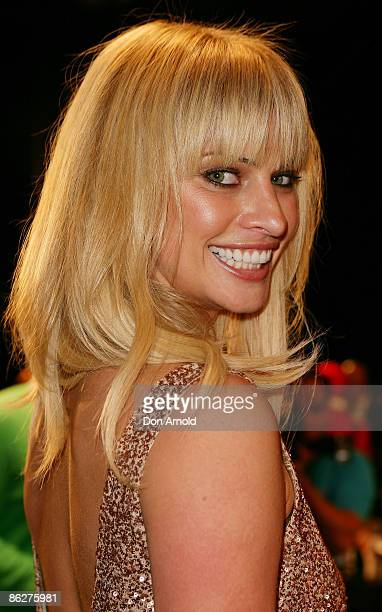Kristy Hinze poses prior to the Jayson Brunson show on the catwalk at the Overseas Passenger Terminal, Circular Quay on day three of Rosemount...