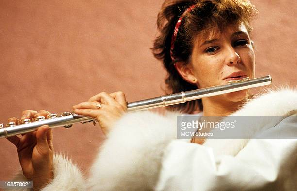 Kristy McNichol plays a flute in a scene from the film 'Just The Way You Are', 1984.