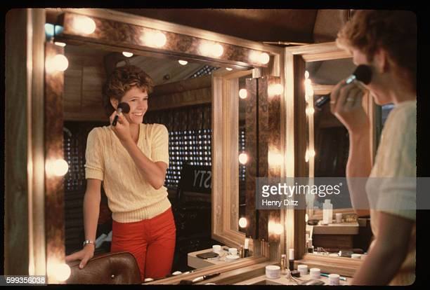 Kristy McNichol puts on makeup for a day on the set