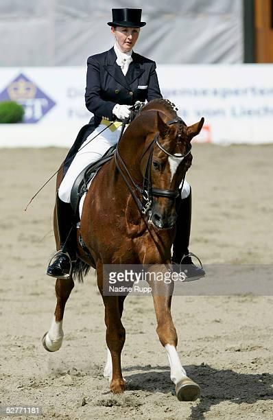 Kristy Oatley of Australia rides her horse Don Bolero during the Grand Prix Kuer Martin Freiherr von Jenisch of the German Jumping and Dressage Grand...
