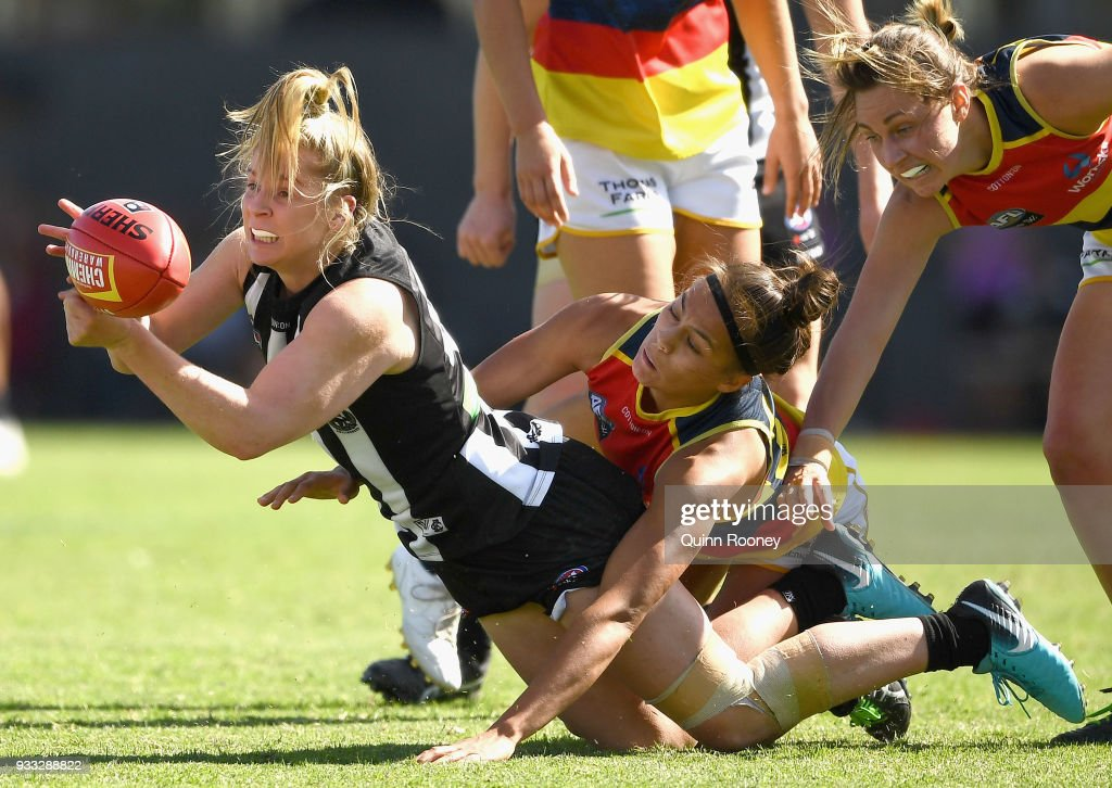 Kristy Stratton of the Magpies handballs whilst being tackled during the round seven AFLW match between the Collingwood Magpies and the Adelaide Crows at Olympic Park on March 18, 2018 in Melbourne, Australia.