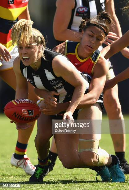 Kristy Stratton of the Magpies handballs whilst being tackled during the round seven AFLW match between the Collingwood Magpies and the Adelaide...