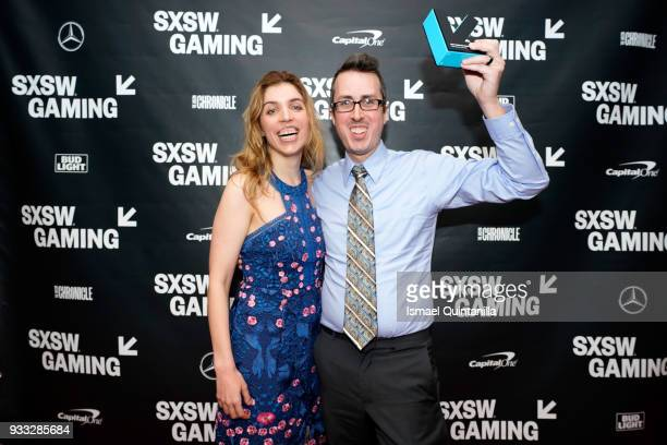 Kristyn Childres and Isaac Childres pose with their award at SXSW Gaming Awards during SXSW at Hilton Austin Downtown on March 17 2018 in Austin Texas