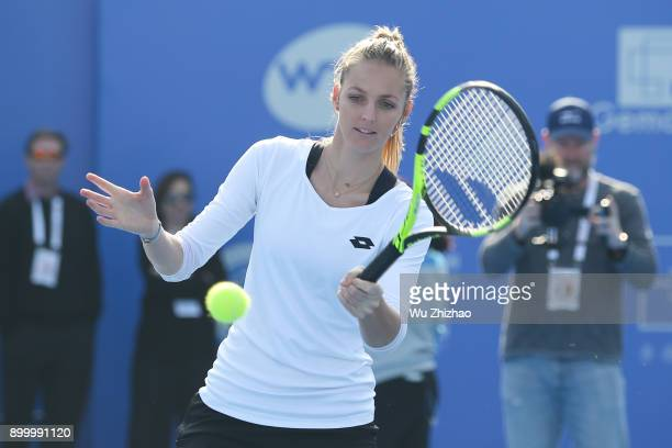 Kristyna Pliskova of Czech Republic plays a game during Kids Day ahead of the 2018 WTA Shenzhen Open at Longgang Sports Center on December 31 2017 in...