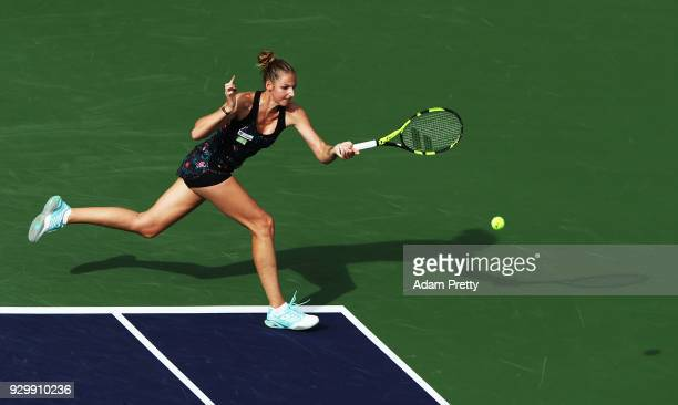 Kristyna Pliskova of the Czech Republic hits a forehand during her match against Simona Halep of Romania during the BNP Paribas Open at the Indian...