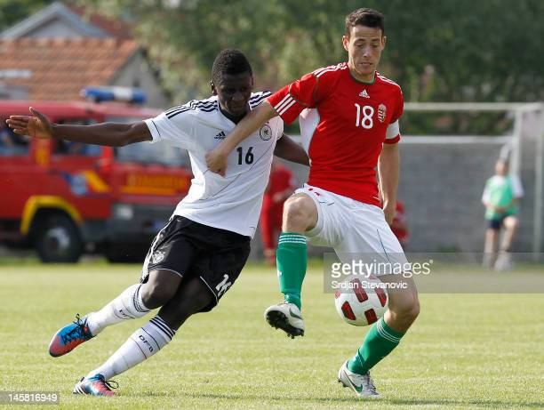 Krisztian Adorjan of Hungary battle for the ball with Danny da Costa Vieira of Germany during the U19 Hungary v U19 Germany Elite Round match at...